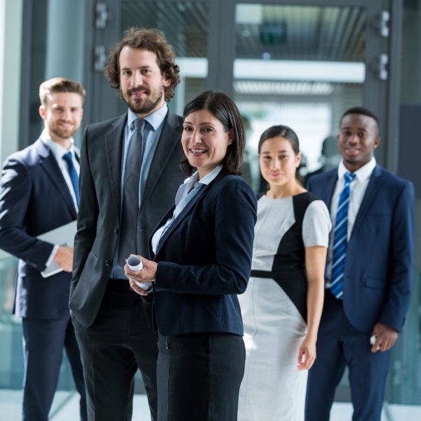 confident-businesspeople-standing-in-office-9WWZ924-scaled.jpg